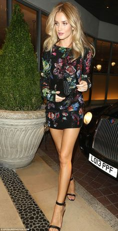 Model behaviour! Rosie Huntington-Whiteley, 29, proved exactly why she is the darling of the fashion world as she left London's Soho Hotel on Tuesday night