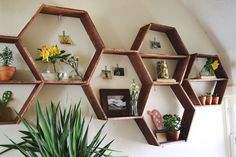I love these honeycomb shelves and the way she's displayed things in them like the photos taped up with washi tape.