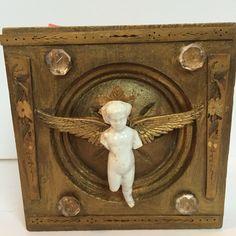 Mixed media assemblage SOLD  antique Frozen Charlotte on Antique architectural trim. Artist Debbie Siday