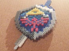 3-D Hyrulian Shield Perler / Hama beads by Primalstrike