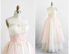 vintage 1950s wedding dress / pink wedding dress / 50s White and Blush Butterflies and Roses Wedding Gown. $224.00, via Etsy.