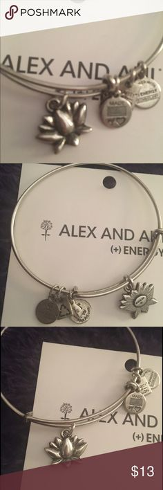 "Alex & Ani Lotus Blossom Bangle The Lotus Blossom is a symbol of beauty, strength, and grace. The strong stem's connection to the flower represents an eternal, unbreakable bond between two people. Spiritually enlightening and divinely beautiful, the Lotus Blossom Charm reminds us that our relationships and shared hearts are the key to happiness. Great Condition. Have large white paper & a box   The perfect addition to your charmed arm • Expandable from 2"" to 3.5"" • Charm Dimension: 0.75 x…"