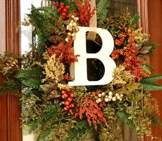 Love this initial wreath for the front door! I found a big wreath of dried berries at Salvation Army for super cheap this weekend; now I just need the letter & some ribbon.