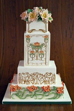 Place a double-thick tier in the center of the cake— it makes a great canvas for a painting.  Cake by Elegantly Iced (=)