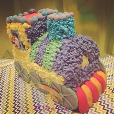 Themed Cakes - Happy Train Themed and Shaped Cake | All Things Yummy #traincake #trainthemecake #train #wheels #trainshapedcake #customisedcake #carvedcake #buttercreamcake #buttercream #chocolatecake #choochootrain #chimney #buttercreamicing #buttercreamstars #stars #atyummy #fondant #littleboy #kidsbirthday #birthdaycake #colorfulcake #atyummy #bakedwithlove