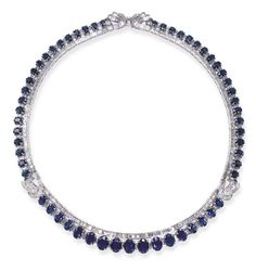 A SAPPHIRE AND DIAMOND NECKLACE   Designed as a baguette-cut diamond line, enhanced by graduated oval-cut sapphire trim, spaced by baguette-cut diamonds, the shoulders and clasp accented by a baguette-cut diamond ribbon motif, mounted in 18k white gold, 15¾ ins.