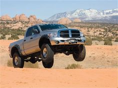 Google Image Result for http://dodgepowerwagon.net/wp-content/uploads/2011/04/0807dp_01_z%2B2007_dodge_ram_2500_power_wagon%2Bjump_view.jpg
