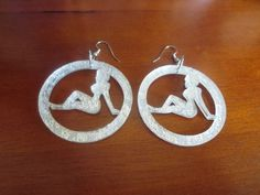 "One word...""Foxy!""These earrings hang about 2 inches from a silver ear hook."
