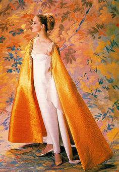 NINA RICCI evening dresses related more closely to a simple silhouette but were made with exclusive rich fabrics and luxurious surface decoration.  1960's Photo from Glamour in Fashion by David Bond 1992. )minkshmink)