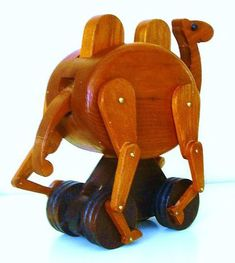 Wooden Camel toy driven by a cam mechanism