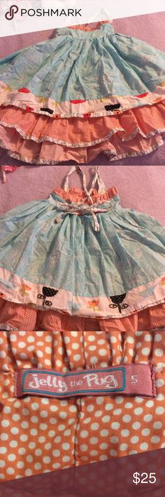 Girls dress Super adorable  girls dress with beautiful flower and polkadot fabric excellent condition straps are adjustable and it bows in the back this is a super adorable dress Jelly The Pug Dresses Casual
