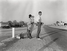 "Traveling Light: August 1936. ""Oklahoma farm family on highway between Blythe and Indio. Forced by the drought of 1936 to abandon their farm, they set out with their children to drive to California. Picking cotton in Arizona for a day or two at a time gave them enough for food and gas to continue. On this day they were within a day's travel of their destination, Bakersfield. Their car had broken down en route and was abandoned."" Medium-format negative by Dorothea Lange."