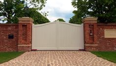 Custom Accoya Automated Driveway Gates Painted with 'Teknos Old White' in Halstead