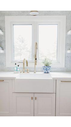 Brass faucet blanco silk granite apron front sink white kitchen designed by Andrea McQueen Design in Burlington Ontario