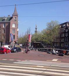 Westertoren vanuit de Marnixstraat over de Bloemgracht heen.