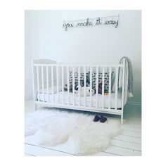 Such a cute babies room from featuring the 'Herds' cushion covers by Skinny laMinx, and Heath Nash's wire words.