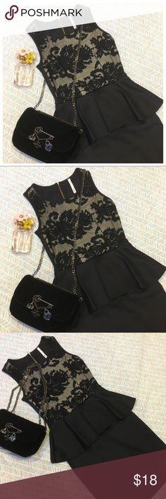 Lace Peplum Dress Lovely lace peplum dress in black, fit and flare style, zipper back. Front panel has a layer of floral design mesh lace with a beige / cream under layer. Full length: 32 in, from shoulder to waist: 14 in and the skirt part: 18 in. Waist laid flat: 12 in. Fits XS-S. Material: polyester and spandex, stretchy. Excellent used condition, like new. Feel free to ask any questions. Joyce Leslie Dresses Mini