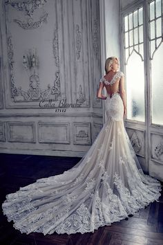 Calla Blanche wedding dress/gown- Leia, ivory trumpet style wedding dress with lace, illusional deep sweetheart neckline and cap sleeves. For the Bride Boutique, Ft. Myers, FL