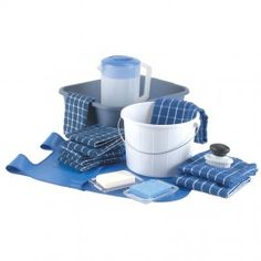 Table Washing Activity  Lay down a floor cloth. Set out supplies. Fetch the water. Scrub, sponge, dry… includes every item needed for a successful experience.