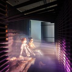 Visitors to an exhibition of work by architects Haptic can take a rest inside a wooden cabin filled with coloured light and smoke (+ movie).