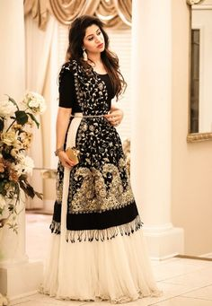 I am loving the trending fashion of lehngas/flowy skirts like any other girl! This trend has made a mark on the Pakistani fashion industry since the past couple of years. This beautiful, ivory ski… Indian Gowns, Indian Attire, Pakistani Dresses, Indian Wear, Indian Lehenga, Pakistani Bridal, Black Lehenga, Indian Bridal, Indian Wedding Outfits