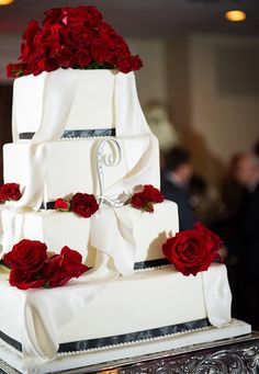 Square cake with red roses and monogram.  Design by Specialty Wedding Cakes.  #weddingcakes, #massachusettsweddingcakes,#specialtyweddingcakes