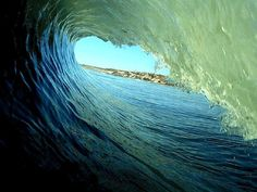 from http://www.thecoolist.com/wave-photography-spiraling-surf/wave-photography_9/