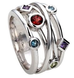 White gold ring featuring a mix of gemstones. Gemstones are personalized to reflect your family's birthstones.