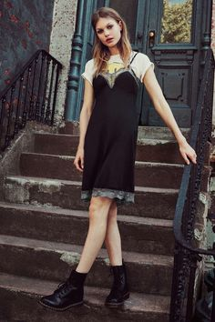 black lace slip over a t shirt with doc martens.
