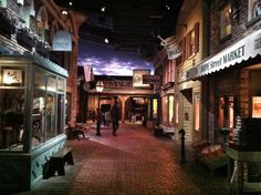"""COSI museum - """"Progress exhibit"""", Columbus, Ohio.  The exhibit features a walk through a town, with models of a street with various storefronts. The vignette scenes are  set to depict commerce during America's Gilded Age, c.1898. ~ {cwlyons}"""