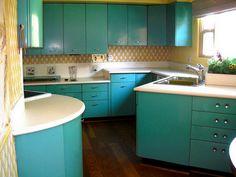 Cool vintage aqua kitchen.