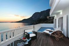 Villa More in Makarska, Dalmatia.  Handsome, elegant and exquisitely appointed, Villa More is a truly exceptional holiday villa set in an enviable position on the shores of the Adriatic. With the beach right outside your door, breathtaking views across the bay from all three floors and thoughtfully arranged, stylish accommodation throughout, this is a perfect choice for large families or friends staying together.