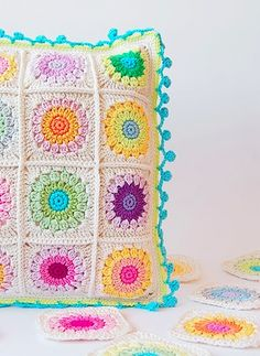 Crochet this beautiful  DIY baby pillow that will brighten up any nursery.