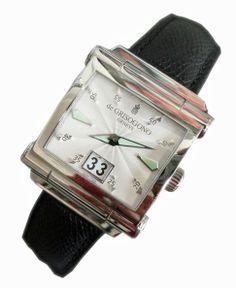 Stainless steel Swiss made De Grisogono Instrumento Grande.  http://www.liveauctioneers.com/item/25627256_stainless-steel-de-grisogono-instrumento-grande-watch