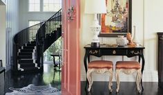Kelly Wearstler: Pink & black dramatic entry foyer design with glossy black wood floors, black curving ...