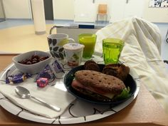 Delicious breakfast at the hospital after surgery. Coffee, rye bread with ham, cheese and salad, yogurt, orange juice, water, biscuits, grapes and Fazer chocolade.