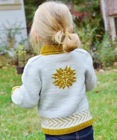A stranded snowflake motif at the center back of this cardigan adds a festive touch, and makes Spruce Island a lovely sweater to wear throughout the holiday season and into the winter. Find this children's pattern at LoveKnitting.Com.