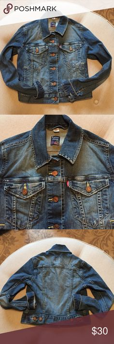 Levi's Juniors Jean Jacket Traditional Levi's jean jacket in a junior's small. It's a short style with longer sleeves. Levi's Jackets & Coats Jean Jackets