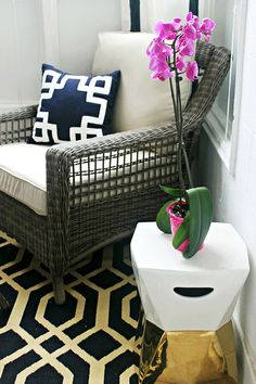 Black and white with pink accents... lovely! That's the lounge chair from the Spring Haven Grey Outdoor Collection moved indoors to this small sunroom. It's a good look for a casual living room, too. See more decorating ideas from Shannon Claire of Burlap and Lace... on The Home Depot Blog.  || @burlapandlace