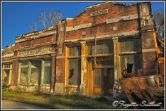 "Discover Spectre Set Ruins in Millbrook, Alabama: The remains of an idyllic small town built for the film ""Big Fish"" still stand around a rundown main street. Abandoned Film, Abandoned Buildings, Abandoned Places, Film Big, Small Town America, Small Places, Big Fish, Ghost Towns, Main Street"