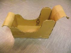 how to make a christmas sleigh OUT OF CARBORD | ... cardboard, folding it up to make the front and back of your sleigh