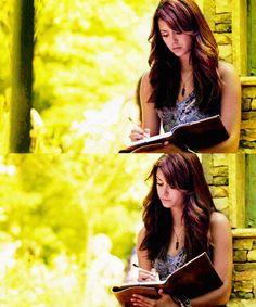Elena Gilbert writing in her diary again.