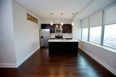 Our 680 square foot luxury loft. Sleek modern design with the best views of Lafayette Square in the City.