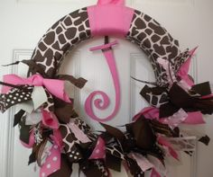 Giraffe baby girl ribbon wreath in pinks for nursery, hospital door hanger and baby showers.