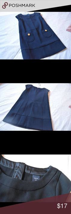 Navy Blue/ Black Dress A navy blue or black dress with two pockets with two gold button decorations. Perfect for an 8 year old girl. Rarely worn, like new. GAP Dresses Midi