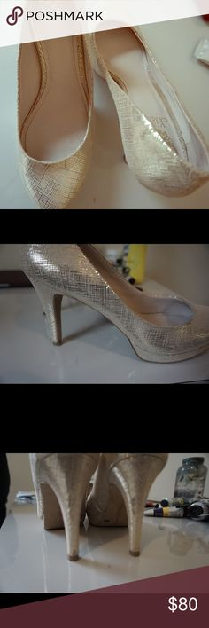 Vince Camuto gold heels Only worn once to graduation. Vince Camuto gorgeous gold heels with a platform are so easy to walk in. Vince Camuto Shoes Heels