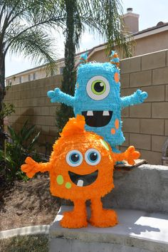 Little Monsters Custom Pinata Orange and Blue by angelaspinatas