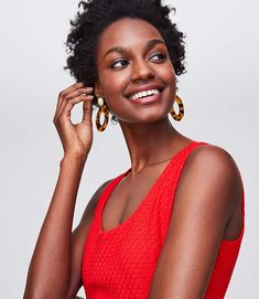 This eyelet flounce dress takes an easy approach to flattering perfection