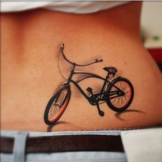 Realistic tiny bicycle tattoo by Denis Sivak