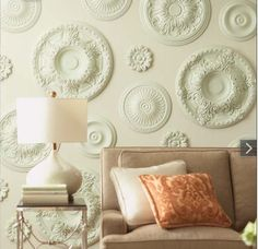 Oh, how I love this! - Ceiling medallions from the home improvement store!  I say add some mirrors to the centers and put color behind on the walls or color the medallions.  Fun and easy!